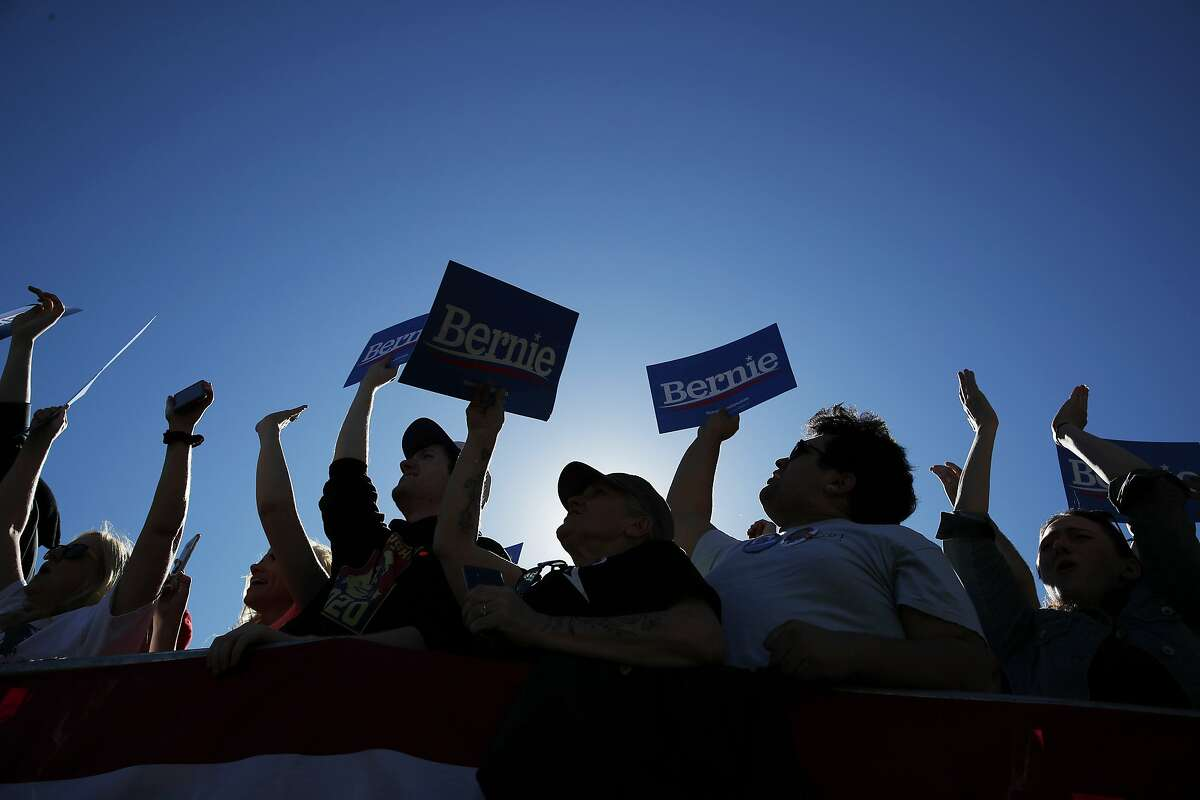 Supporters of 2020 Democratic presidential candidate Sen. Bernie Sanders cheer at a rally Saturday, March 16, 2019, in Henderson, Nev. (AP Photo/John Locher)