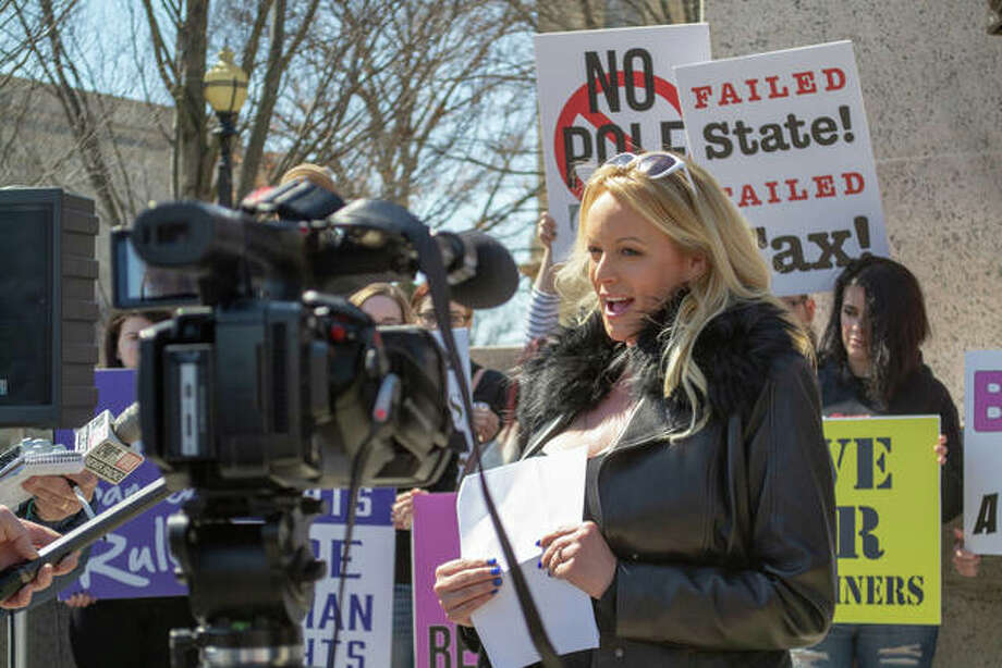 Adult film entertainer Stormy Daniels, whose real name is Stephanie Clifford, is pictured at an appearance at the Illinois State Capitol Friday. Daniels spoke for about two minutes, reading from prepared remarks against a six-year-old adult entertainment facilities tax, the proceeds of which support organizations that provide aid to victims of sexual assault. After the Capitol appearance, Daniels' schedule included a book-signing at a Springfield adult entertainment facility. Photo: Photo By Jerry Nowicki | Capitol News Illinois