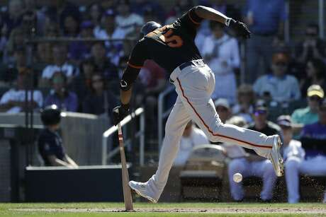 San Francisco Giants' Cameron Maybin runs into his bunt for an out against the Colorado Rockies during the second inning of a spring baseball game in Scottsdale, Ariz., Sunday, March 3, 2019. (AP Photo/Chris Carlson)