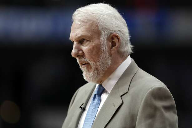 San Antonio Spurs coach Gregg Popovich watches play in the closing minutes of the team's NBA basketball game against the Dallas Mavericks in Dallas, Tuesday, March 12, 2019. (AP Photo/Tony Gutierrez)