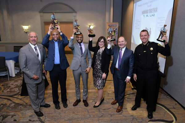 The annual Albany Police Athletic League Breakfast of Champions was held at the Albany Marriott Hotel on March 14. This year?s event recognized Jamion Christian, Siena College Mens Head Coach (2nd from left); Nathaniel Burke, PAL Alumni; CAP COM FCU, Amanda Goyer (accepting for Paula Stopera and CAP COM); David Bauer, PAL Chairman and Sheriff Craig Apple, for their outstanding support and commitment to PAL and area youth. PAL Executive Director Lenny Ricchiuti pictured far left.