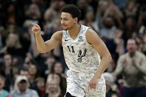 San Antonio Spurs guard Bryn Forbes celebrates a score against the Portland Trail Blazers during the second half of an NBA basketball game in San Antonio, Saturday, March 16, 2019. San Antonio won 108-103. (AP Photo/Eric Gay)