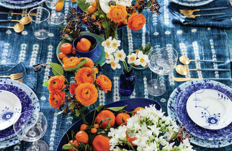 Ariella Chezar sets a table with kumquat branches, viburnum sprigs, anemones, orange ranunculus, yellow-centered narcissus and paperwhites. If narcissus isn't in season, substitute tiny white orchids.