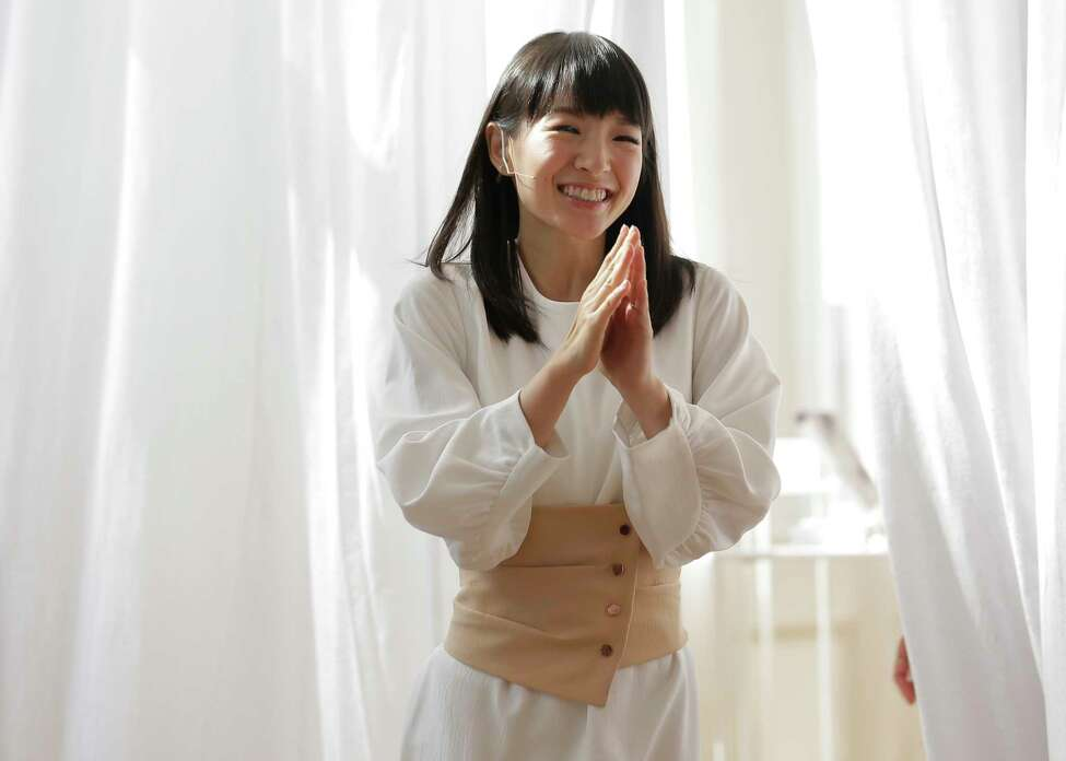 FILE- In this July 11, 2018, file photo, Japanese organizational expert Marie Kondo appears at a media event to introduce her new line of storage boxes in New York. Kondo is sparking joy among shoppers feeling the urge to clean out their homes. But once you master the Japanese organizing expert?s novel approach to de-cluttering, what do you do with all the stuff you don?t want? (AP Photo/Seth Wenig, File)