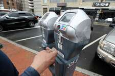 A customer is photograph on Thursday, March 21, 2019 paying for parking on West Park Place in Stamford, Connecticut. The city plans to increase fees to park at city meters, garages and lots downtown, which downtown merchants and powerbrokers don't want.