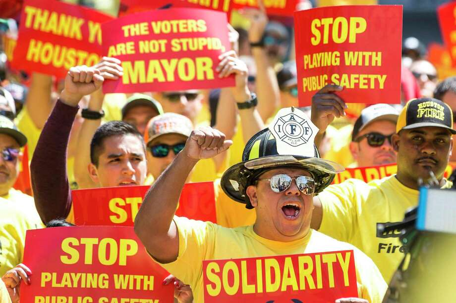 Houston firefighters demonstrate during a march on City Hall by the Houston Professional Fire Fighters Association over the labor dispute related to Proposition B on Tuesday, March 19, 2019, in Houston. >>Some of the largest recent Houston layoffs Photo: Brett Coomer, Houston Chronicle / Staff Photographer / © 2019 Houston Chronicle