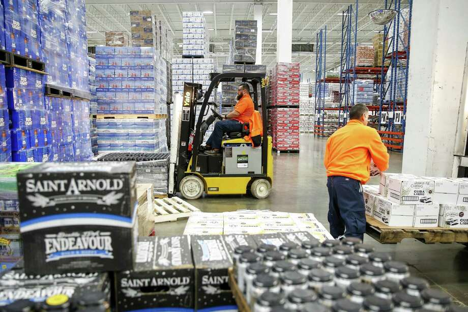 Silver Eagle Distributors warehouse supervisor Joseph Vasquez, left, loads a pallet of beer onto a forklift Thursday, May 10, 2018 in Houston. (Michael Ciaglo / Houston Chronicle) Photo: Michael Ciaglo, Staff Photographer / Houston Chronicle / Michael Ciaglo