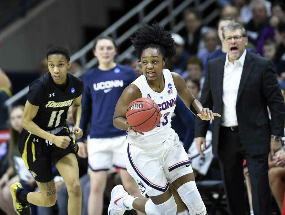 UConn's Christyn Williams (13) heads downcourt with encouragement from coach Geno Auriemma, right, during Friday's NCAA Tournament first-round game against Towson in Storrs. Photo: Stephen Dunn / Associated Press / Copyright 2019 The Associated Press. All rights reserved