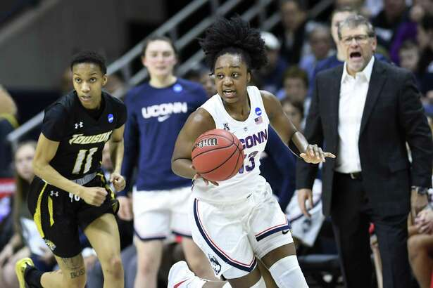 UConn's Christyn Williams (13) heads downcourt with encouragement from coach Geno Auriemma, right, during Friday's NCAA Tournament first-round game against Towson in Storrs.