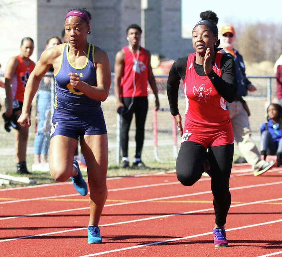 Alton's Jeanea Epps (right) and O'Fallon's Zoie Howard battle side-by-side in the early stages of the 100-meters Friday at the Southwestern Illinois Relays in Edwardsville. Howard won the race with Epps in second. Photo: Greg Shashack / The Telegraph