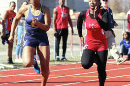 Alton's Jeanea Epps (right) and O'Fallon's Zoie Howard battle side-by-side in the early stages of the 100-meters Friday at the Southwestern Illinois Relays in Edwardsville. Howard won the race with Epps in second.