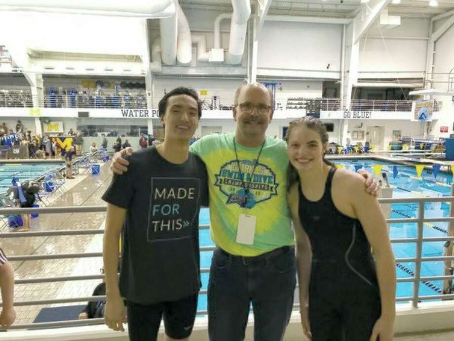 From left, Collin Che, Kronos coach Chilly Smith and Claire Newman