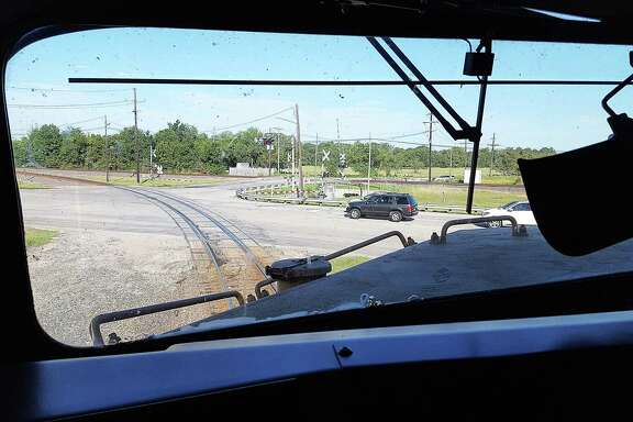 From the cabin of Union Pacific Engine 5410, the conductor and engineer can see vehicles who are supposed to be stopped and out of the way of the train as it prepares to cross.