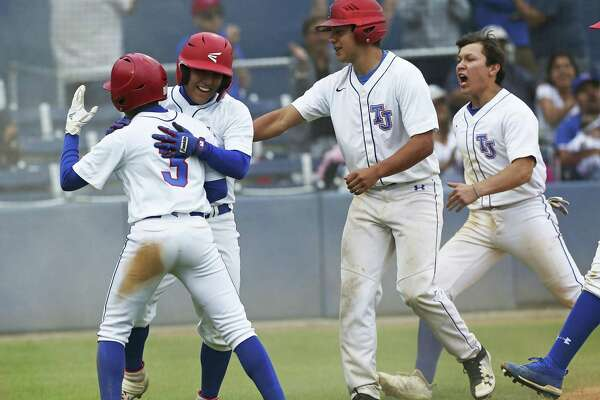 Jason Romo celebrates with his teammates after scoring to win the game in the bottom of the seventh on a pass ball at home plate as Jefferson beats Highlands 5-4 in high school baseball at the SAISD Sports Complex on March 22, 2019.