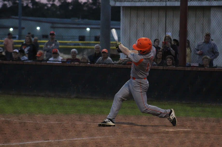 Orangefield's Johnny Armstong takes a swing against Kountze on Friday night. Photo: Meshach Sullivan  / The Enterprise