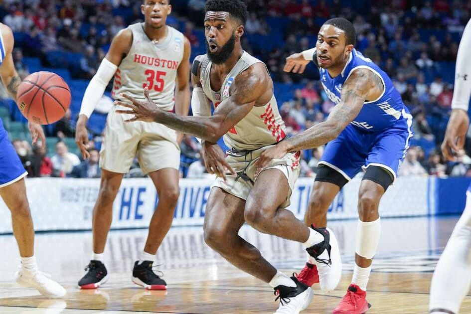 Houston Cougars guard Corey Davis Jr. (5) dishes the ball of in the paint in the first half against Georgia State in the first round of NCAA playoffs at BAK Center on Friday, March 22, 2019 in Tulsa. Davis had six assists in the win.