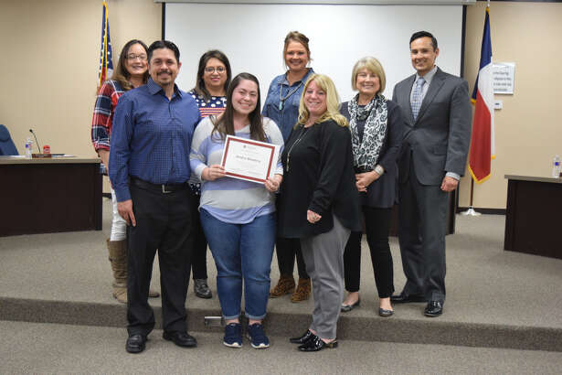 Jordyn Ramirez stands with her parents, Nicki and Raymund Ramirez, and members of the Plainview ISD School Board after being recognized during the board's regular monthly meeting on Thursday.