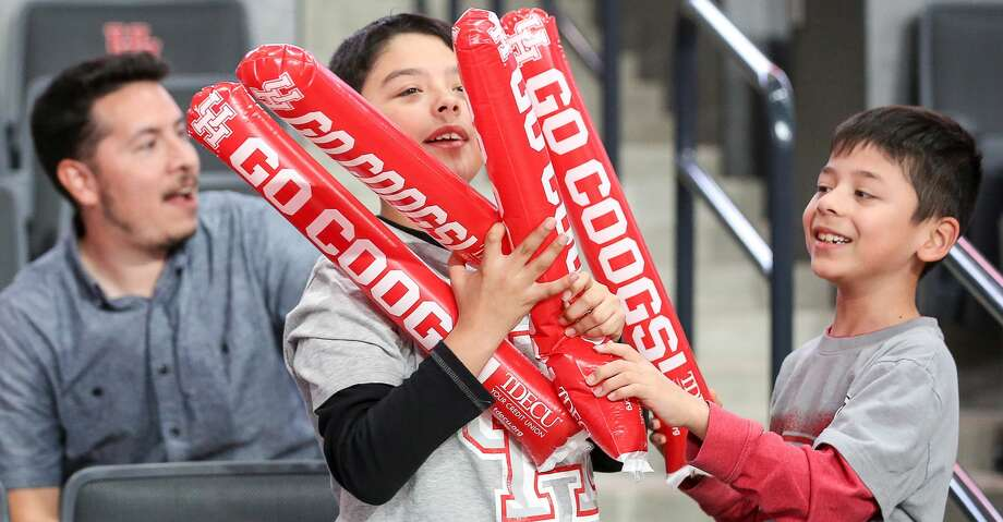 PHOTOS: UH vs. Georgia State Christopher Garcia, 10, center, and his brother, Eric Garcia, 7, right, play during a watch party for the NCAA tournament selection at the Fertitta Center at the University of Houston Sunday, March 17, 2019, in Houston. Browse through the photos to see action from UH's win over Georgia State in the first round of the NCAA Tournament. Photo: Jon Shapley/Staff Photographer