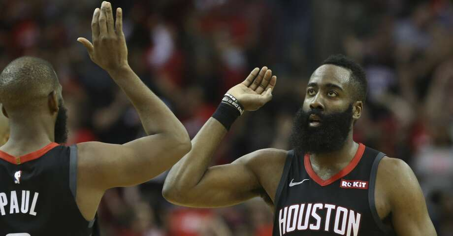 Houston Rockets guard James Harden (13) high-fives teammate Chris Paul during the fourth quarter of the NBA game against the San Antonio Spurs at Toyota Center on Friday, March 22, 2019, in Houston. The Houston Rockets defeated the San Antonio Spurs 111-105. Photo: Yi-Chin Lee/Staff Photographer