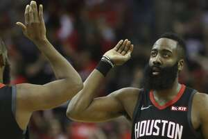 Houston Rockets guard James Harden (13) high-fives teammate Chris Paul during the fourth quarter of the NBA game against the San Antonio Spurs at Toyota Center on Friday, March 22, 2019, in Houston. The Houston Rockets defeated the San Antonio Spurs 111-105.