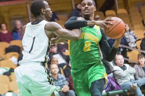 Albany Patroons forward Edwin Ubiles goes to the basket against Yakima SunKings forward Renaldo Major at the Washington Avenue Armory on Friday, March 22, 2019. (Jim Franco/Special to the Times Union)