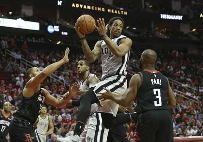 8e16c65fdf98 San Antonio Spurs guard DeMar DeRozan (10) looks to pass the ball under the  basket during the third quarter of the NBA game against the Houston Rockets  at ...