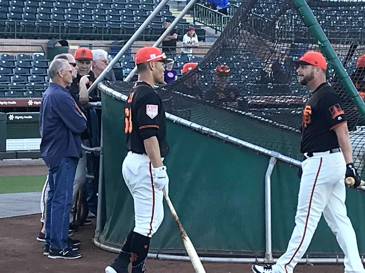 New Giants Connor Joe, left, chats with catcher Stephen Vogt during batting practice Friday.