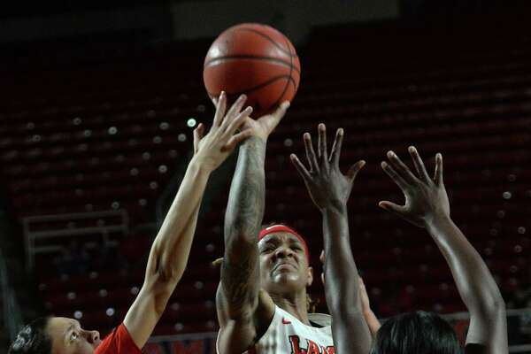 Lamar's Moe Kinard finds an opening to shoot against South Alabama's defense during their opening round of WNIT tournament play Friday at the Montagne Center. Photo taken Friday, March 22, 2019 Kim Brent/The Enterprise