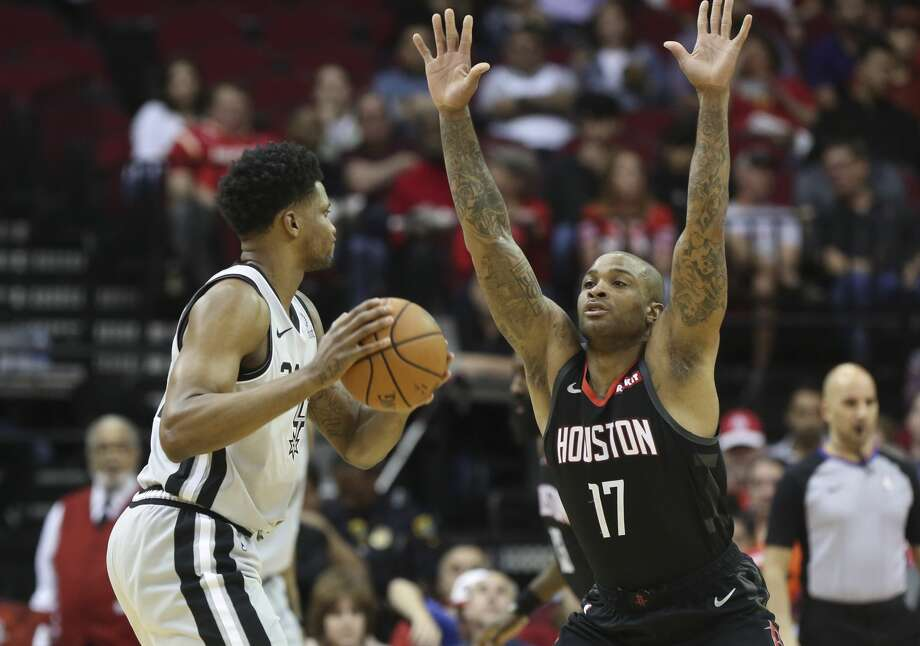 Houston Rockets forward PJ Tucker (17) guarding San Antonio Spurs forward Rudy Gay (22) during the first quarter of the NBA game at Toyota Center on Friday, March 22, 2019, in Houston. Photo: Yi-Chin Lee/Staff Photographer