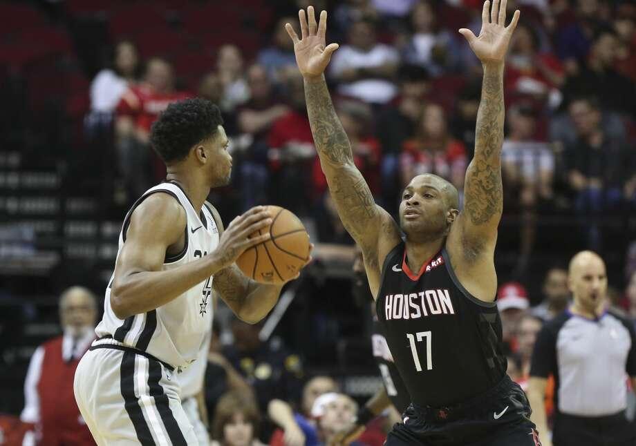 591d845c2 Houston Rockets forward PJ Tucker (17) guarding San Antonio Spurs forward  Rudy Gay (