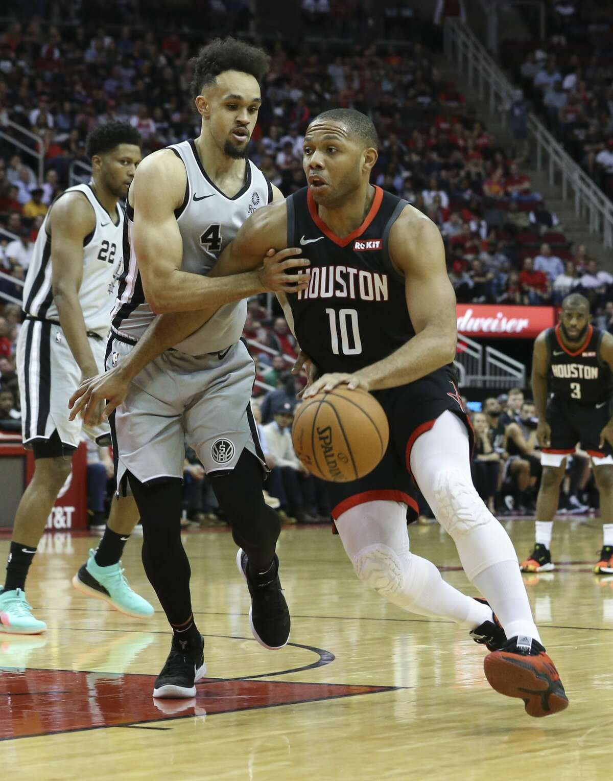 Houston Rockets guard Eric Gordon (10) dribbles toward the basket while San Antonio Spurs guard Derrick White (4) is defensing during the second quarter of the NBA game at Toyota Center on Friday, March 22, 2019, in Houston.