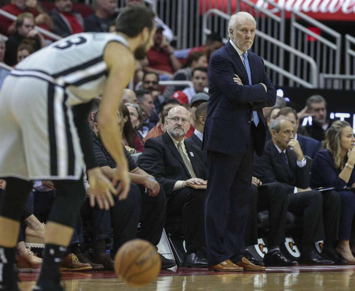 San Antonio Spurs head coach Gregg Popovich wathces his player playing during the first quarter of the NBA game against the Houston Rockets at Toyota Center on Friday, March 22, 2019, in Houston.