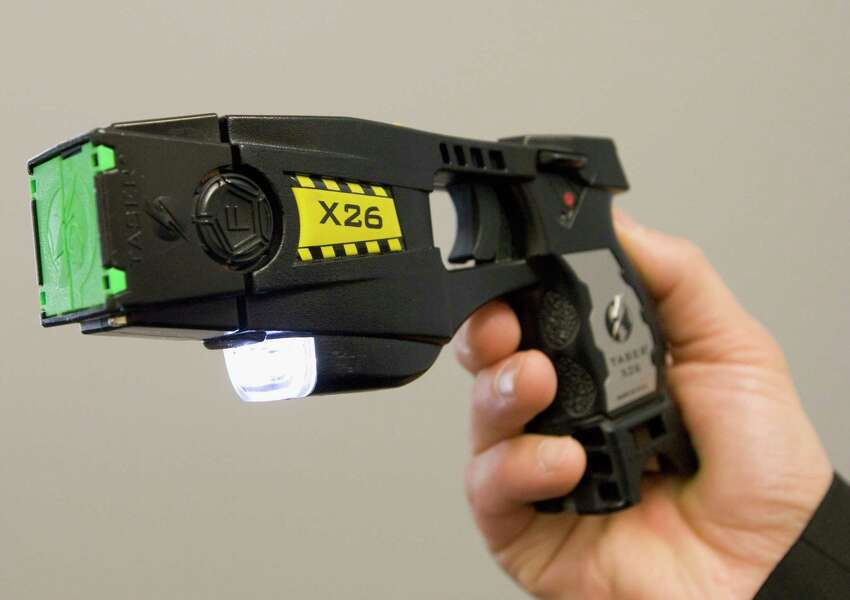 FILE- In this May 7, 2008 file photo, a police issued taser is displayed at the Victoria police station in Victoria, British Columbia. On Friday, March 22, 2019 a federal judge has ruled that New York's ban on personal ownership of stun guns is unconstitutional. Friday's ruling by a district judge in Utica, N.Y., is the latest in a series of court decisions that have led to the loosening of restrictions on the weapons in several states. (Jonathan Hayward/The Canadian Press via AP, File)