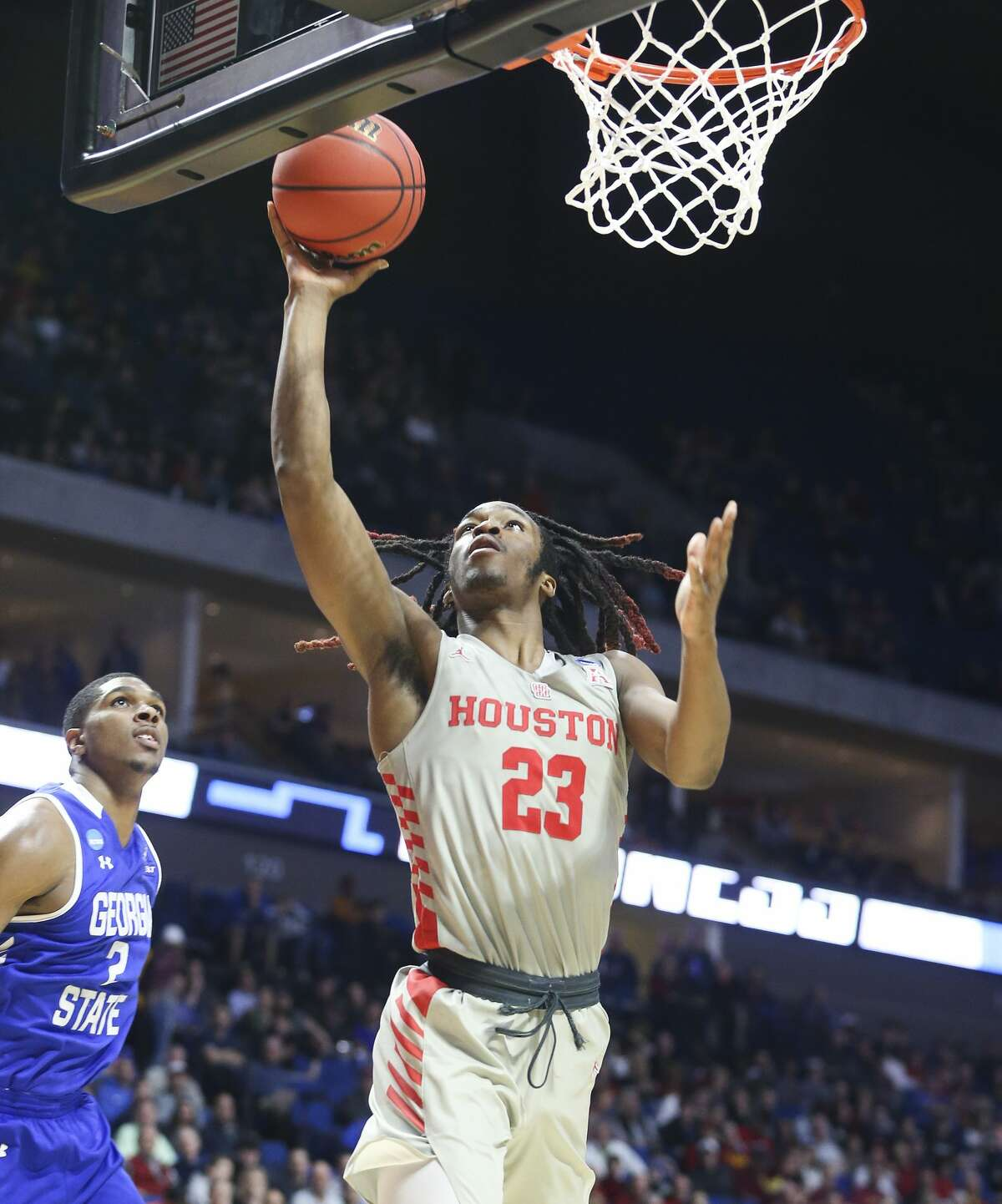 Houston Cougars forward Cedrick Alley Jr. (23) drives to the basket past Georgia State Panthers forward Malik Benlevi (2) at BAK Center on Friday, March 22, 2019 in Tulsa. Houston won the game 84-55.