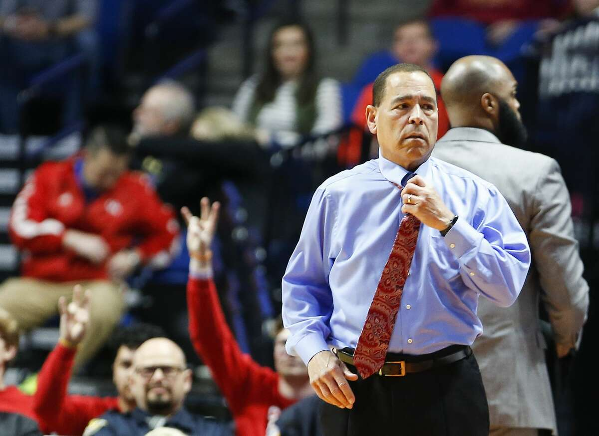 Houston Cougars head coach Kelvin Samspon adjusts his tie during the the first round of NCAA playoffs at BAK Center against Georgia State Panthers on Friday, March 22, 2019 in Tulsa. Houston won the game 84-55.