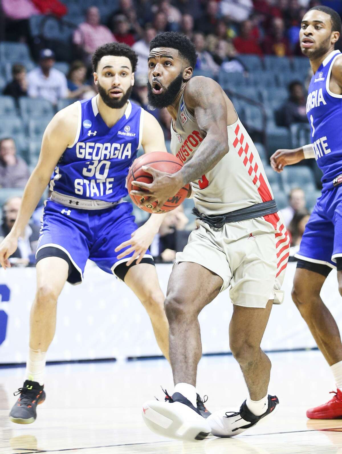 Houston Cougars guard Corey Davis Jr. (5) drives past Georgia State Panthers forward Jeff Thomas (30) as he makes his way to the basket in the first round of NCAA playoffs at BAK Center on Friday, March 22, 2019 in Tulsa. Houston won the game 84-55.