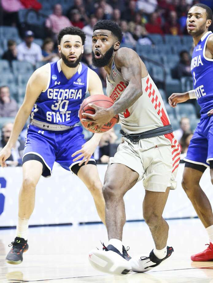 Houston Cougars guard Corey Davis Jr. (5) drives past Georgia State Panthers forward Jeff Thomas (30) as he makes his way to the basket in the first round of NCAA playoffs at BAK Center on Friday, March 22, 2019 in Tulsa. Houston won the game 84-55. Photo: Elizabeth Conley/Staff Photographer