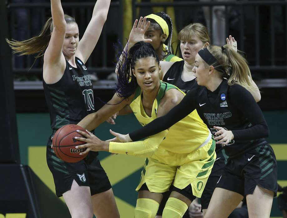 Oregon's Satou Sabally (center), who had 21 points and 16 rebounds, looks for a way out against Portland State. Photo: Chris Pietsch / Associated Press