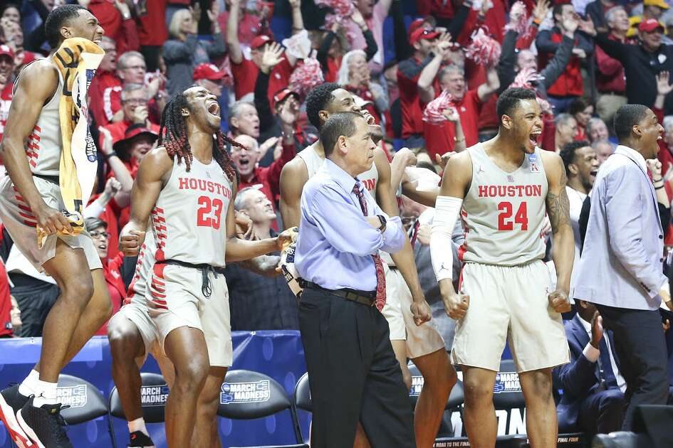 Houston Cougars starters react as Houston Cougars center Caleb Broodo (30) scores in the final seconds of the first round of NCAA playoffs at BAK Center on Friday, March 22, 2019 in Tulsa against Georgia State Panthers. Houston won the game 84-55.
