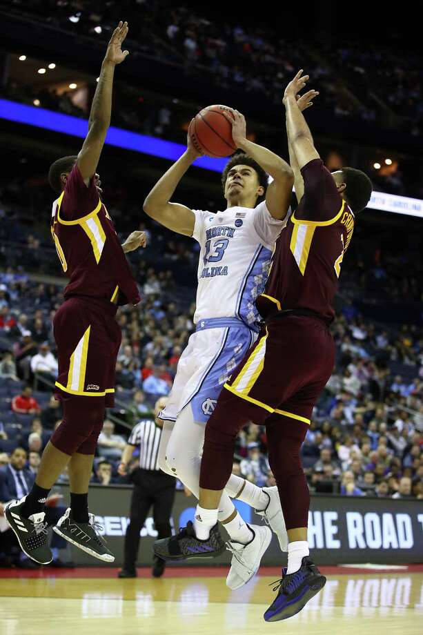 Cameron Johnson #13 of the North Carolina Tar Heels shoots during the second half of the game in the first round of the 2019 NCAA Men's Basketball Tournament March 22, 2019. Photo: Gregory Shamus / 2019 Getty Images