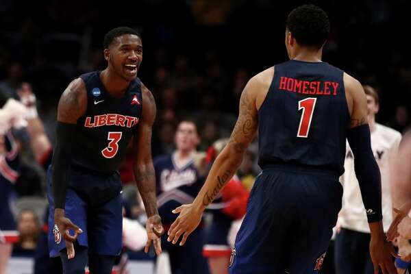 SAN JOSE, CALIFORNIA - MARCH 22: Lovell Cabbil Jr. #3 of the Liberty Flames reacts to a play against the Mississippi State Bulldogs during their game in the First Round of the NCAA Basketball Tournament at SAP Center on March 22, 2019 in San Jose, California. (Photo by Ezra Shaw/Getty Images)