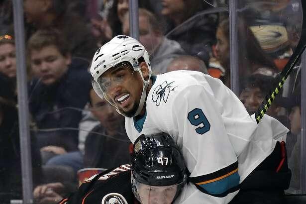 Anaheim Ducks' Hampus Lindholm (47) collides with San Jose Sharks' Evander Kane (9) during the third period of an NHL hockey game Friday, March 22, 2019, in Anaheim, Calif. (AP Photo/Marcio Jose Sanchez)
