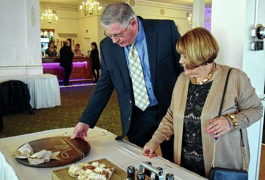 Anne and Dude Wildrick of Jacksonville view the silent auction items Friday during the Mia Ware Foundation Gala at Hamilton's Catering. Photo: Samantha McDaniel-Ogletree | Journal-Courier