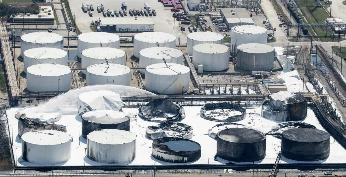 Emergency crews continue to douse what's left of the now-extinguished petrochemical tank fire at Intercontinental Terminals Company on Wednesday, March 20, 2019, in Deer Park.