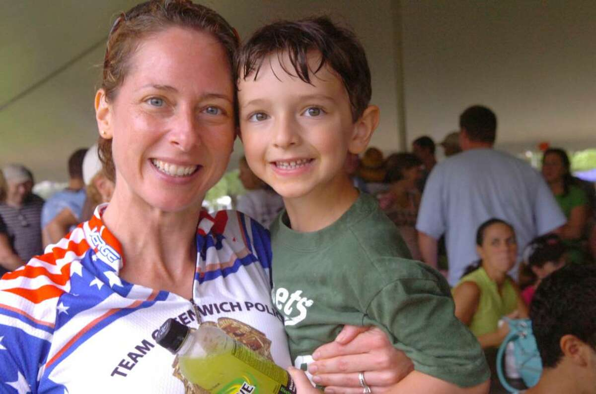 Greenwich police detective Christy Girard and her son, Harris, 4, at the barbeque after the three-day bicyle ride to raise money for the fight against ALS, on Sunday, July 25, 2010.