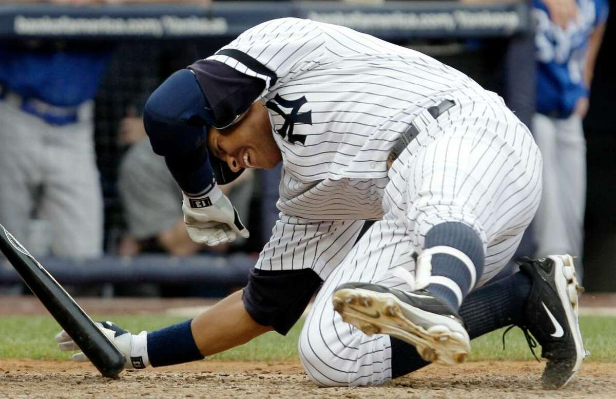 New York Yankees' Alex Rodriguez falls to the ground after being hit by Kansas City Royals' Blake Wood's eighth-inning pitch with bases loaded in a baseball game at Yankee Stadium on Sunday, July 25, 2010, in New York. (AP Photo/Kathy Willens)