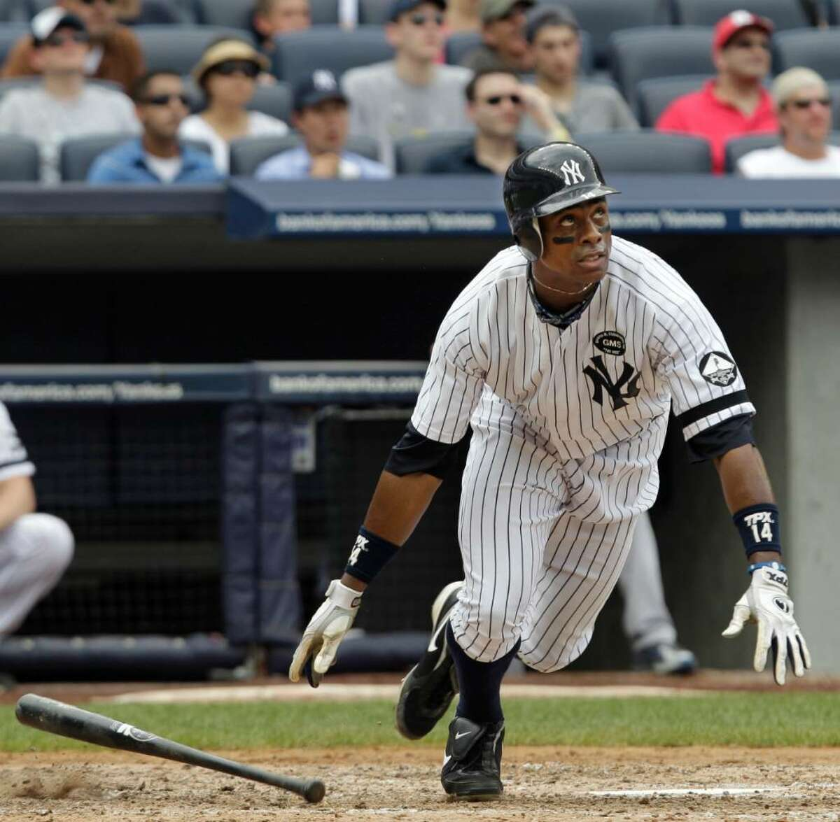 New York Yankees' Curtis Granderson watches his fourth-inning solo home run off Kansas City Royals starting pitcher Sean O' Sullivan in a baseball game at Yankee Stadium on Sunday, July 25, 2010, in New York. (AP Photo/Kathy Willens)