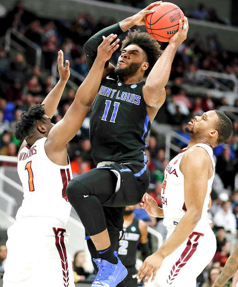 Saint Louis University forward Hasahn French, middle, shoots between Virginia Tech guard Isaiah Wilkins, left, and forward P.J. Horne in Friday night's NCAA Tournament game in San Jose, Calif. Saint Louis forward Hasahn French, middle, shoots between Virginia Tech guard Isaiah Wilkins, left, and forward P.J. Horne during the first half of a first-round game in the NCAA men's college basketball tournament Friday, March 22, 2019, in San Jose, Calif. (AP Photo/Ben Margot)