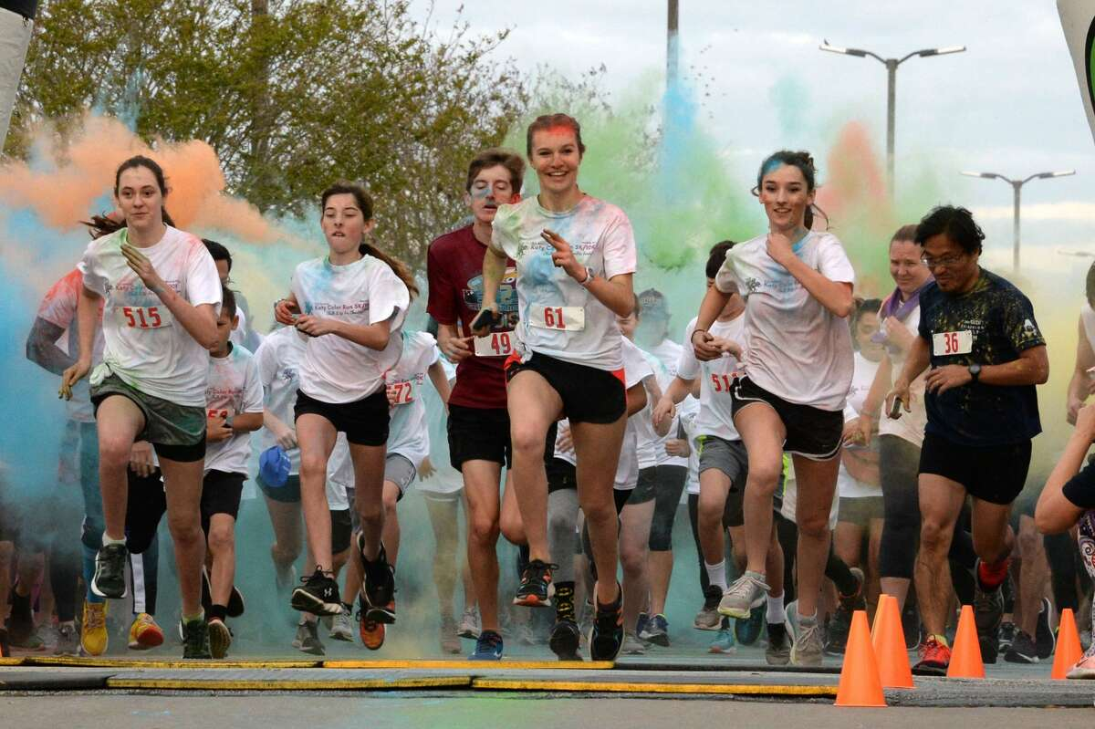 Runners participate in the Katy Color Run in Katy, TX on Saturday, March 23, 2019.