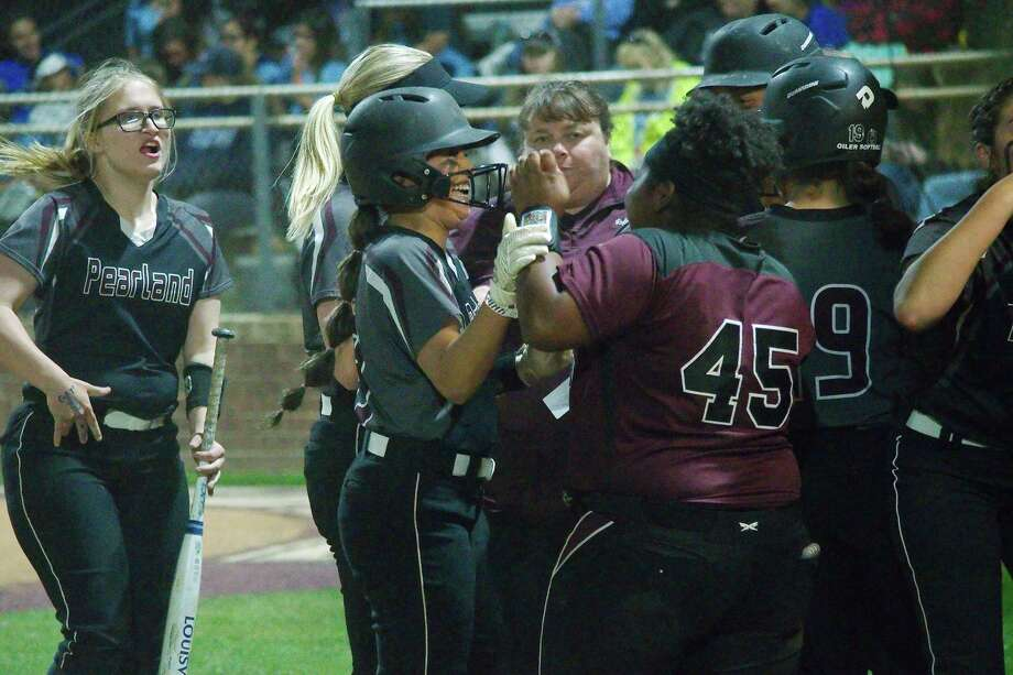 Pearland's Maddison Guillen (13), congratulated after hitting a home run against Brazoswood last year, is one of several key returning starters for the Lady Oiler softball team. Photo: Kirk Sides / Staff Photographer / © 2019 Kirk Sides / Houston Chronicle